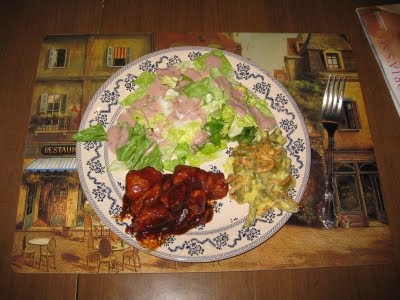 chicken cooked in a sweet sticky sauce plated with a salad