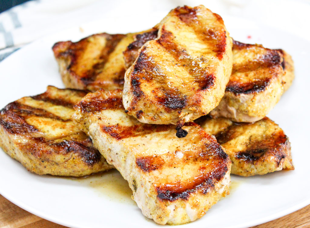 Pork chops on a white plate