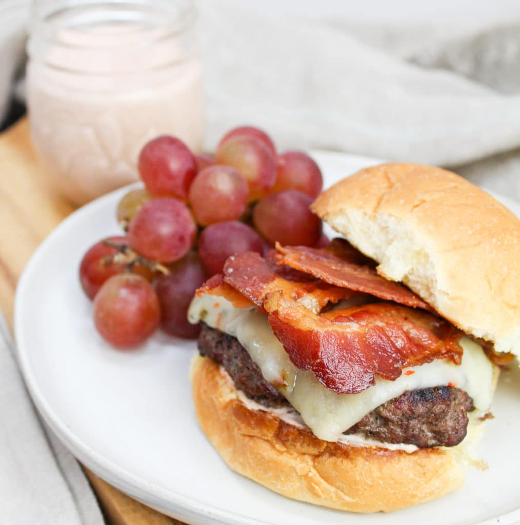 burger on a plate with grapes