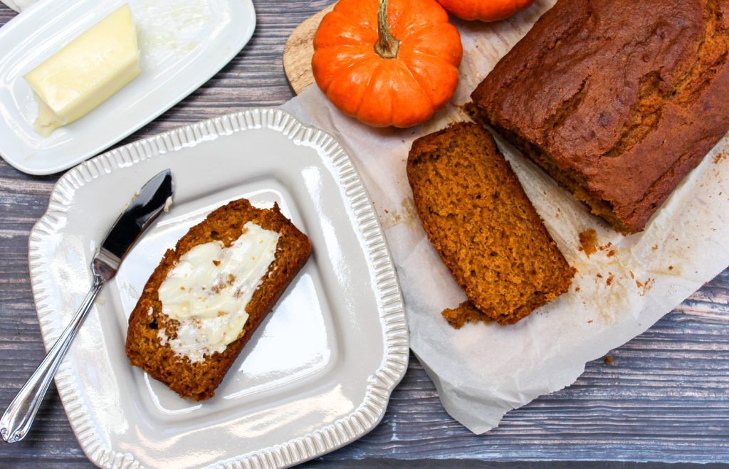 pumpkin bread in a pan and plate