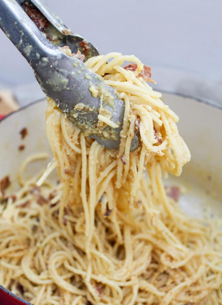 pasta grabbed by tongs