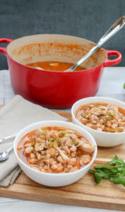 chicken, beans, and pepper soup in a white bowl