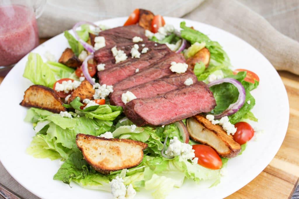 sliced steak on a salad
