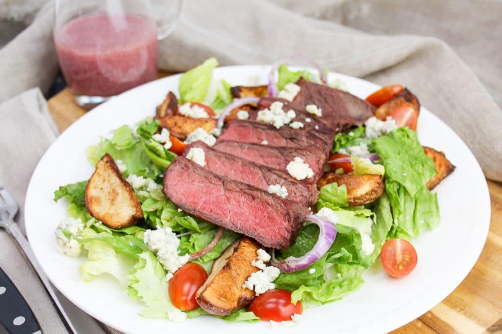 steak sliced on a salad