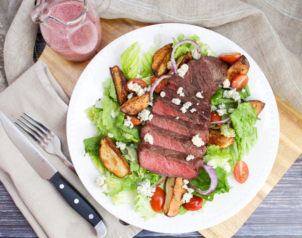 overhead picture of sliced steak on a salad