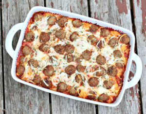 Overhead picture of a casserole topped with meatballs and cheese