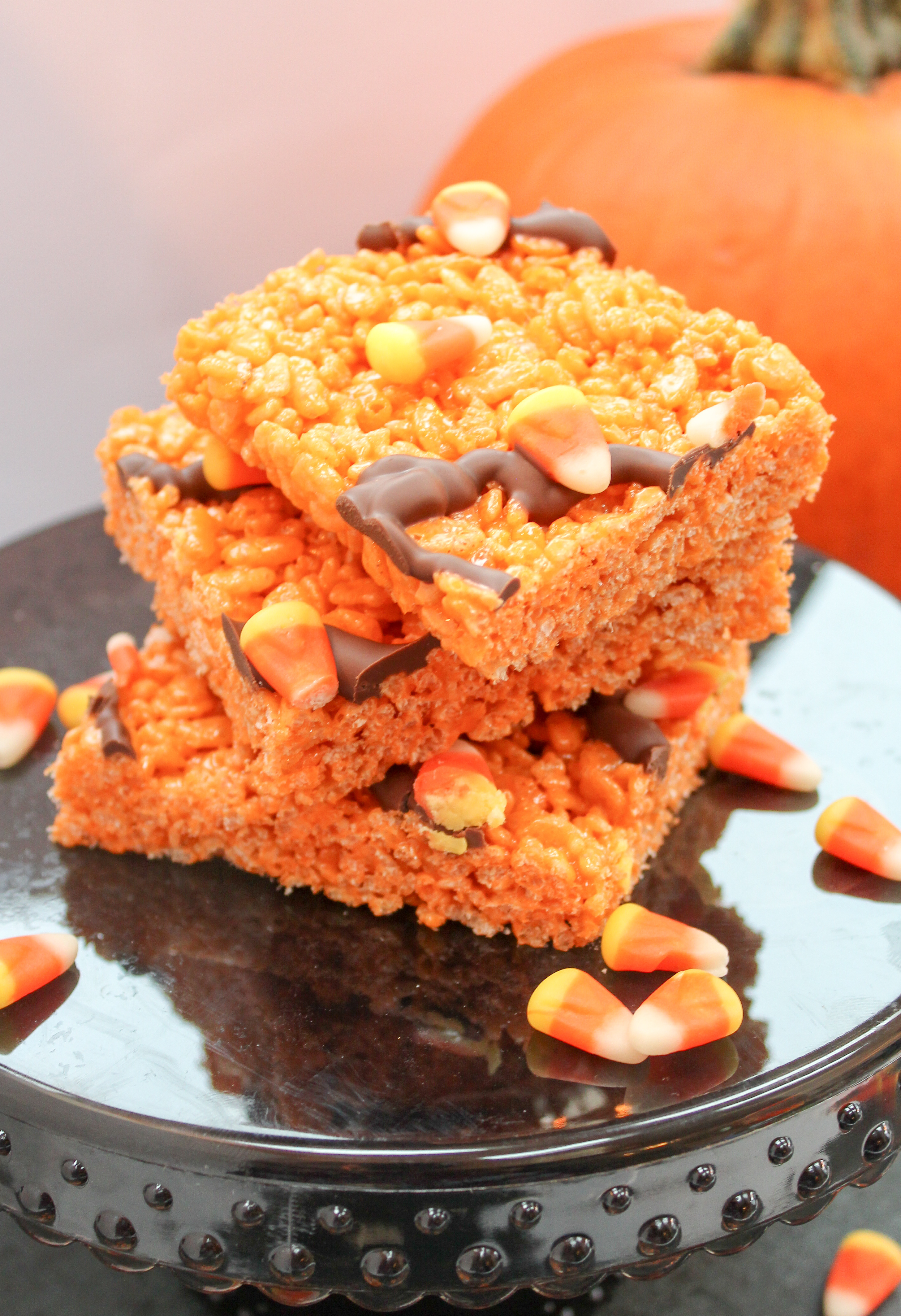 Rice Crispy Cereal cut into squares. Garnished with Candy Corn and Chocolate