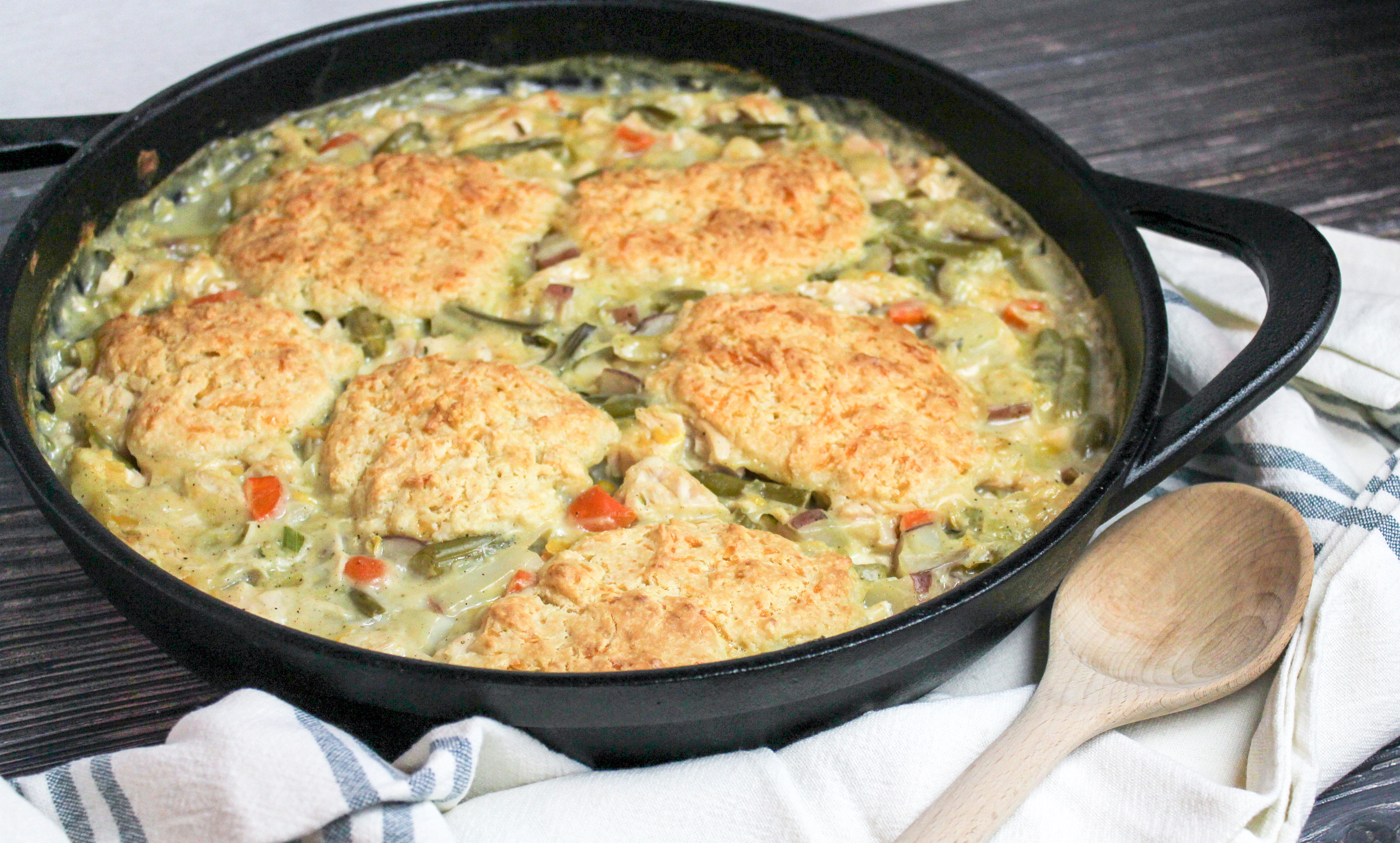 Creamy turkey shredded and baked with biscuits in a cast iron baking dish
