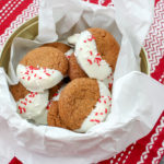 gingerbread cookied dipped in white chocolate in a cookie tin