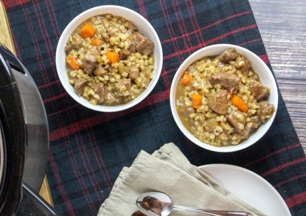 White bowls filled with beef and barley stew