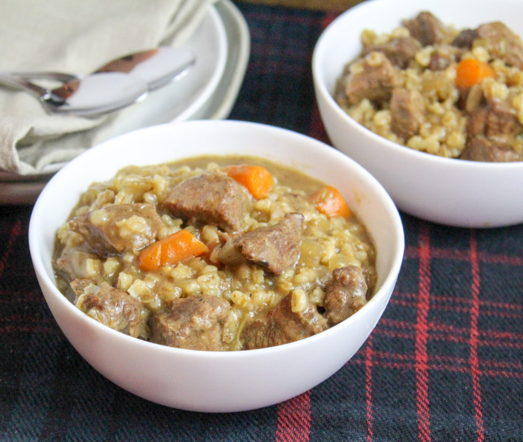 White bowls filled with beef ad barley stew