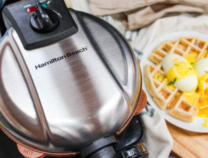 Waffles and eggs on a plate with waffle maker