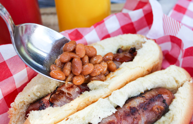 hot dog on the bun with beans