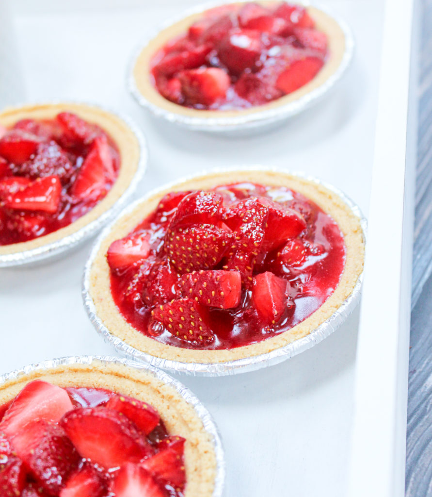mini strawberry pies on a platter