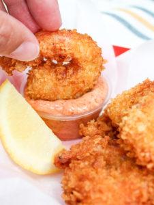 Cajun shrimp dipped in sauce