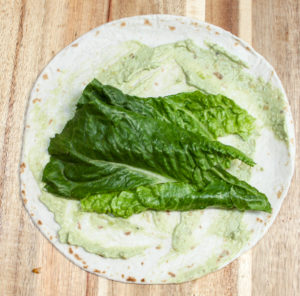 avocado and lettuce on a tortilla