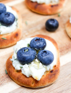 Naan with blueberries on a cutting board