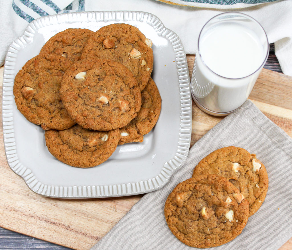 pumpkin cookies on a plate with milk
