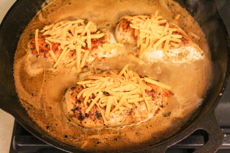 chicken with cheese in the skillet