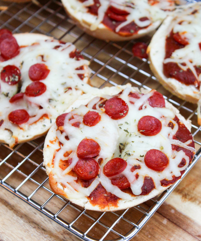 pizza bagels on a cooling rack