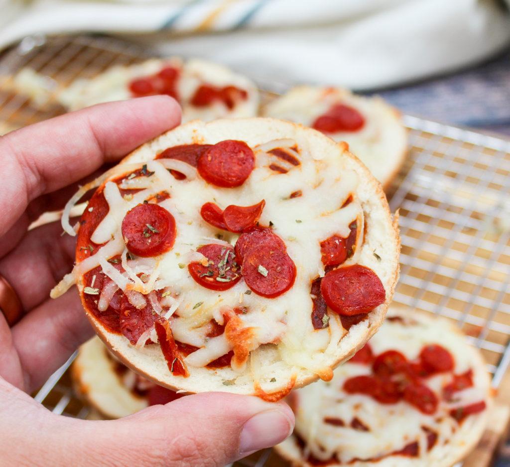 pizza bagels held in hand