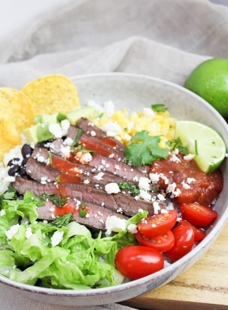 burrito bowl in white dish