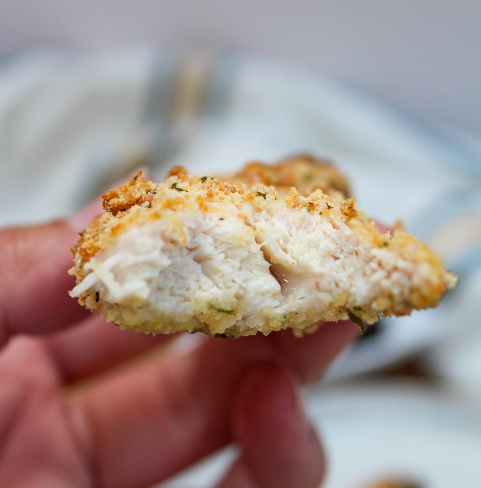 front shot of chicken tender with a bite