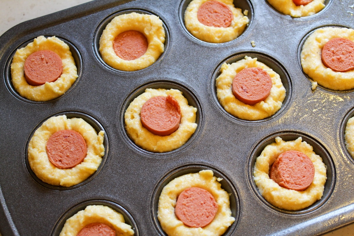 corn dog muffin uncooked in pan