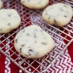 whipped chocolate chip shortbread cookies on a cooling wrack
