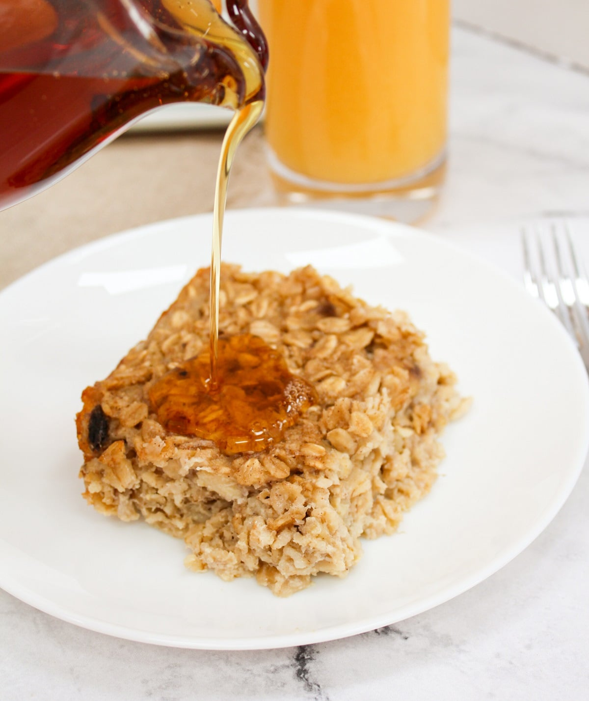 plated oatmeal with syrup poured on top
