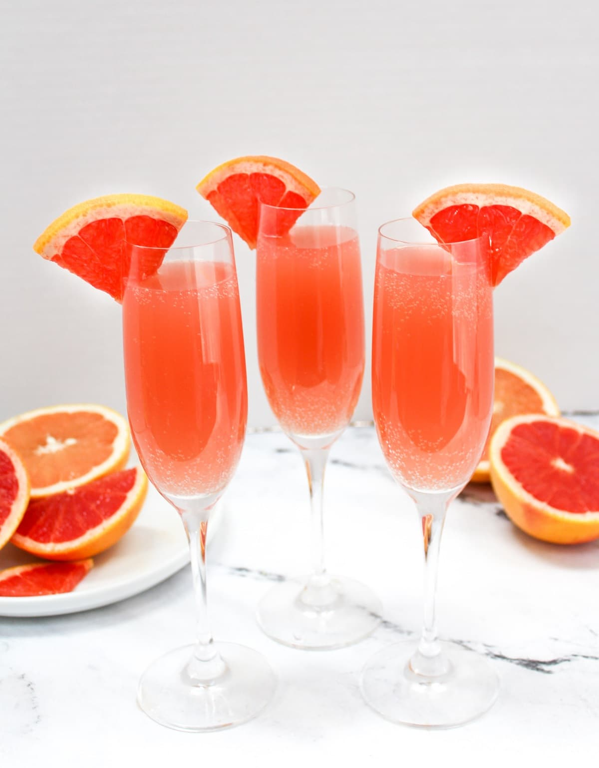 rose mimosas garnished with grapefruit slices